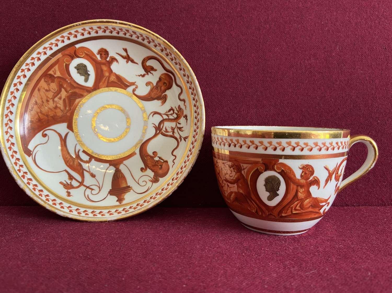 A Coalport Teacup & Saucer decorated in the Studio of Thomas Baxter
