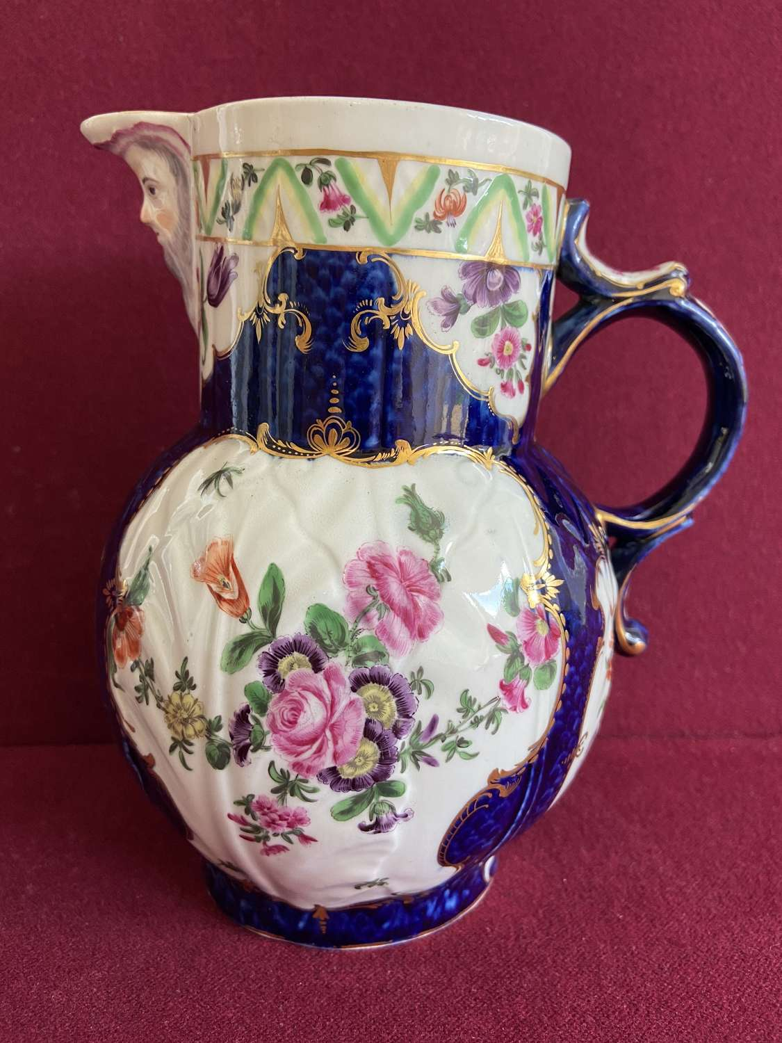 A Fine First Period Dr Wall Worcester 'Blue Scale' Mask Jug c.1770